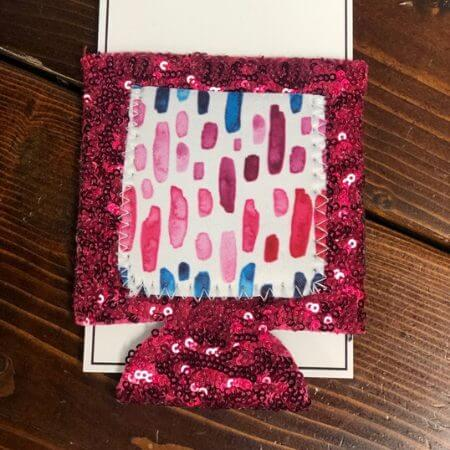 STB Boutique || Pink Watercolor Sequin Can Cooler w/Pocket $ 7.00