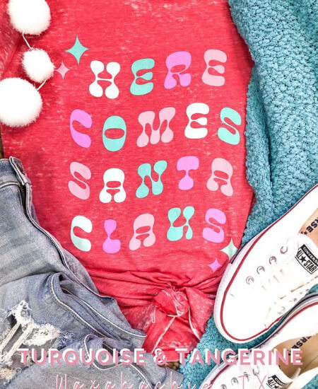 Turquoise and Tangerine || Here Comes Santa Claus T-Shirt $30.99